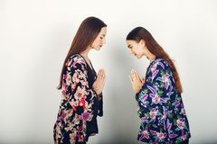 Two beautiful girls in a studio royalty free stock photos
