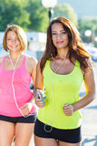 Two cute girls jogging outdoors Stock Photography