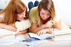 Two cute girls learning with books Royalty Free Stock Image