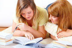 Two cute girls learning with books Royalty Free Stock Images