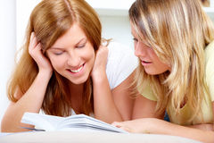 Two cute girls learning with books Royalty Free Stock Photography