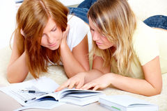 Two cute girls learning with books Stock Image