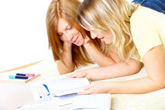 Two cute girls learning with books Stock Images
