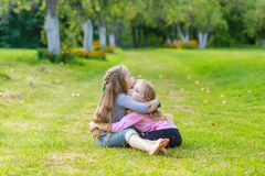 Two cute girls playing in the par Royalty Free Stock Images