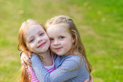 Two cute girls playing in the par Stock Images