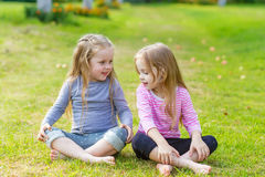 Two cute girls playing in the par Royalty Free Stock Photography