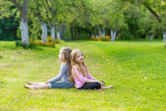 Two cute girls playing in the par Stock Photos