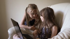 Two cute girls rewritten in social networks and laugh. Family, children, technology and home concept - smiling sister with tablet pc computer and parents on the stock video