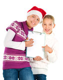 Two cute girls showing a blank paper Stock Photography