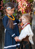 Two cute girls, sisters, standing, holding hands Royalty Free Stock Photo