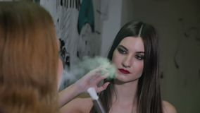 Two cute girls smoke hookah stock video