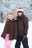 Two cute girls in the snow Stock Photos