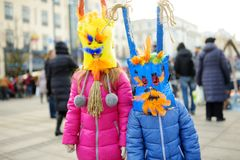 Two cute girls wearing frightening masks during the celebration of Uzgavenes, a Lithuanian annual folk festival taking place seven. Two cute little girls wearing royalty free stock photography