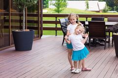 Two cute happy gilrs outdoor. On stairs Stock Photography
