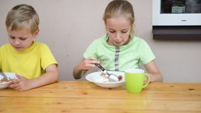 Two cute kid eating stock footage