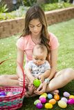 Two cute kids collecting eggs on an Easter Egg hunt outdoors royalty free stock images