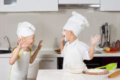 Two cute kids dressed up as chefs Royalty Free Stock Photo