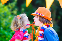 Two cute kids Dutch football supporters Royalty Free Stock Image