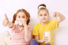 Two cute kids judging milk Stock Photo