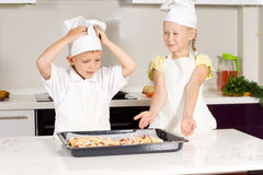 Two Cute Kids Made Appetizing Food Royalty Free Stock Photography