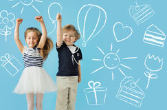 Two cute kids over the drawings background Royalty Free Stock Photos