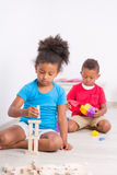Two cute kids play construction set Royalty Free Stock Images