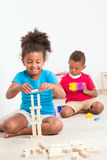 Two cute kids play construction set Stock Photography