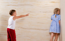 Two Cute Kids Playing Hide and Seek Royalty Free Stock Photography