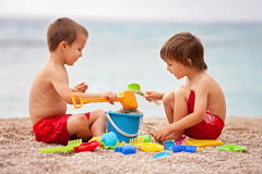 Two cute kids, playing in the sand Stock Photography