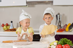 Two Cute Kids Showing Dough They Made Stock Photos