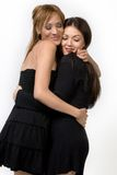 Two cute ladies hugging  Stock Images