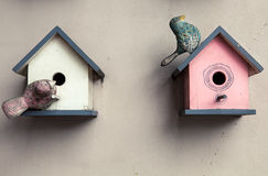 Two cute little birdhouses Royalty Free Stock Photos