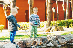Two cute little boys playing outdoor. Royalty Free Stock Photography
