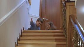 Children play near the stairway stock footage