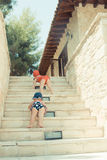 Two cute little girl playing on stairs in the street Stock Photography