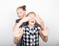Two cute little girlfriend expressing different emotions. Funny kids. Best friends pamper and posing Royalty Free Stock Photo