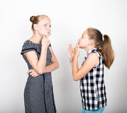 Two cute little girlfriend expressing different emotions. Funny kids. Best friends pamper and posing Royalty Free Stock Photography