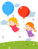 Two cute little girls with balloon Stock Photography