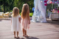 Two cute little girls in beautiful dresses on the Royalty Free Stock Image
