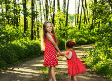 Two cute little girls having fun at summer day Royalty Free Stock Photo
