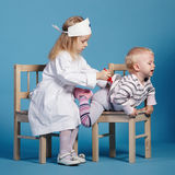 Two cute little girls playing doctor Stock Photos