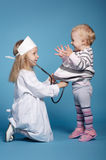 Two cute little girls playing doctor Royalty Free Stock Photography
