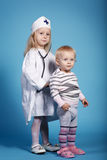 Two cute little girls playing doctor Stock Photography