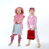 Two cute little girls with shopping bags Royalty Free Stock Photography