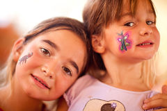 Two Cute Little Girls Showing Their Face Painting At A Party Stock Photos