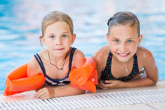 Two cute little girls in swimming pool Royalty Free Stock Photography