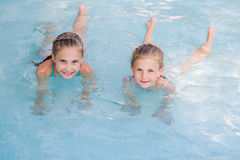 Two cute little girls in swimming pool Stock Photography