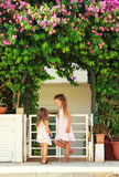 Two cute little girls talking near the house Royalty Free Stock Photography