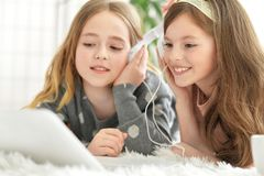 Little girls using laptop. Two cute little girls using laptop together Royalty Free Stock Image