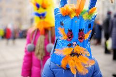 Two cute girls wearing frightening masks during the celebration of Uzgavenes, a Lithuanian annual folk festival taking place seven. Two cute little girls wearing royalty free stock photo